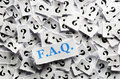 Questions faq question marks on white papers hard light Royalty Free Stock Photography