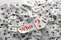Questions who question marks on white papers hard light Royalty Free Stock Images