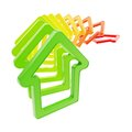 Queue line of house emblems falling down real estate market prices green to red colored as domino effect isolated on white Stock Images