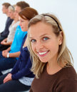 Queue - people sitting in line Royalty Free Stock Photo