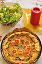 Quiche with courgette and salad Stock Image