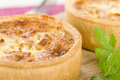 Quiche lorraine individual quiches with bacon cheese and savoury custard Royalty Free Stock Image