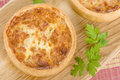 Quiche lorraine individual quiches with bacon cheese and savoury custard Royalty Free Stock Photography
