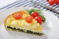 Quiche pie with spinach and cheese traditional french on a plate Stock Photos