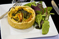 Quiche and salad on a plate Royalty Free Stock Image