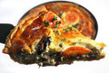 Quiche slice being lifted from a pan Royalty Free Stock Image