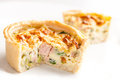 Quiche small with ham broccoli and leek on a white background Royalty Free Stock Image