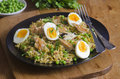 Quick kedgeree with smoked mackerel and herbs Stock Images