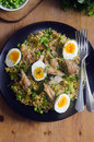 Quick kedgeree with smoked mackerel and herbs Royalty Free Stock Images