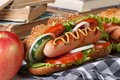 A quick lunch a hot dog and apple during the study horizontal closeup Stock Photos