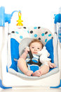 Quiet baby in a swing cute boy home against white background Royalty Free Stock Photos