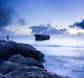 The quiet beach scene reef a breakage bridge a lonely people Stock Image