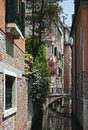 Quiet charming canal venice italy lovely tranquil with bridge and flowers Royalty Free Stock Images