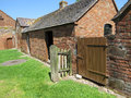 A quiet day on the farm collection of outbuildings that occupy part of shropshire farmyard belonging to boscobel house Stock Image