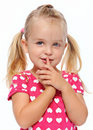 Quiet girl with finger on lips