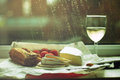 Quiet moments on a rainy day beguette with brie cherry tomatoes and chardonnai Royalty Free Stock Images