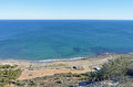 A Quiet Beach From A Cliff Top Royalty Free Stock Photo