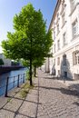 Quiet street in historic district, along a river, on a spring afternoon - Berlin Royalty Free Stock Photo