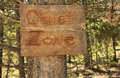 Quiet zone handmade wooden rustic notice of a in a pine forest Royalty Free Stock Images