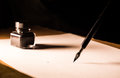 Quill pen ink and paper Royalty Free Stock Photo