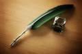 Quill pen and ink well on desk Royalty Free Stock Photo