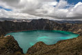 Quilotoa caldera is a water filled that was formed by the collapse of the volcano following a catastrophic eruption about years Stock Images