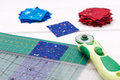 Quilting tools, piece of fabric prepared to cutting, two heaps cut off of fabrics Royalty Free Stock Photo