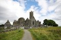 Quin abbey ruins in ireland and cemetery irish country Stock Image