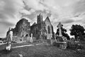 Quin abbey ruins in ireland and cemetery ruin irish country black and white version Stock Photos