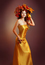 Quin autumn beautiful asian woman in golden dress Royalty Free Stock Images