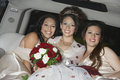 Quinceanera Sitting With Friends In Limousine Royalty Free Stock Photography