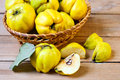 Quinces in the basket on table Royalty Free Stock Photography