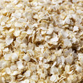 Quinoa flakes in full frame closeup Stock Image
