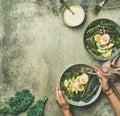 Healthy vegetarian breakfast bowls flat-lay over grey background