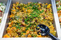 Quinoa and pumpkin salad in a pan in food store Royalty Free Stock Images