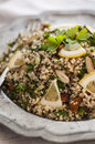 Quinoa salad with almonds and parsley served in old style plate Royalty Free Stock Photos