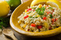 Quinoa salad a healthy delicious with lemon lime red pepper yellow pepper green onion and parsley Stock Photos