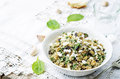 Quinoa spinach eggplant feta salad on a white background the toning selective focus Stock Photo
