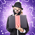 Quirky purple portrait of a knowledgeable business person thinking with finger to fake beard while reading puzzle solving book Royalty Free Stock Photos