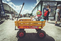 Quirky transport child sat in cart at volksfest bristol festival of and vintage vw transportation Stock Photos