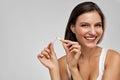 Quit Smoking. Beautiful Happy Woman Holding Broken Cigarette Royalty Free Stock Photo