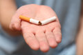 Quit smoking today man trying to a broken cigarette on the palm conceptual image close up Stock Image