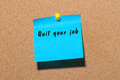Quit your job - inscription on blue sticker pinned at notice board. New life challenge