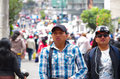QUITO, ECUADOR - JULY 7, 2015: Two unidentified mens walking in the middle of the event, full of people. Pope Francisco Royalty Free Stock Photo