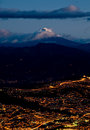 Quito at night with cotopaxi mountain Stock Image