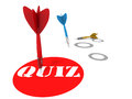 Quiz dart hitting a label on floor with others missing the target in background Stock Image