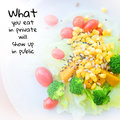 Quote what you eat in private will show up in public over colorful salad background Stock Images