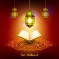 Quran with lamp on Eid Mubarak background