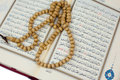 Quran and rosary on white background Royalty Free Stock Photo