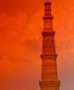 Qutab minar during sunset image of with like background is one of the famous monuments in delhi india which was built by a Royalty Free Stock Image
